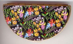 RARE half moon shaped compact with vibrant fuchsia pattern on the front