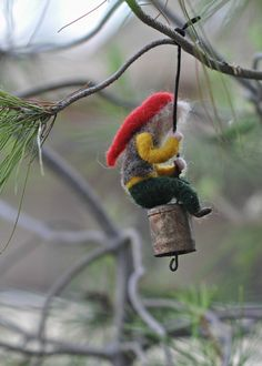 This little needle felted gnome swinging on a vintage bell is just too precious! Of course by dariaIvovsky ♥ Needle Felted Waldorf Climbing Gnome/Wool Mobile/ Christmas ornament / Soft sculpture
