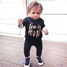 Handsome little Leo celebrated his first birthday in style with his personalised birthday t-shirt! Happy birthday little man, I hope you all had a great day! Leo wears a black t-shirt with gold print. This design is also available printed on heather grey or white and on a baby bodysuit if your babe is still tiny.