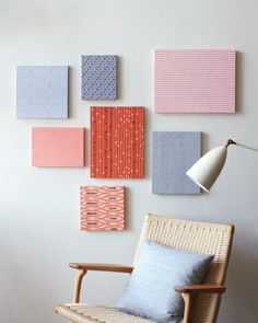 """""""Quickly add color and texture to bare walls by wrapping fabric, including scraps from other projects, around wooden artist's panels. No framing is necessary, and only one nail is required to hang them. To maximize the impact, cluster multiple panels covered in complementary prints."""""""