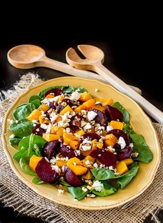 Spinach Salad with roasted Butternut Squash, Beets, Feta, chopped hazelnuts and balsamic.  A delicious, fresh and health salad for the holidays.