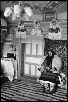 Henri Cartier-Bresson // ROMANIA,1975.  Region of Maramures. Village of Birsana. Sunday morning. A peasant in her home.