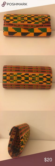 African cloth clutch African cloth clutch made in Ghana. Used only once, very much like new Bags Clutches & Wristlets