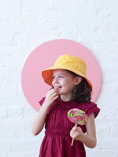 Reversible Bucket Hat | Free Sewing Patterns | Oliver + S --------- linked is the actual pattern site, but here's a cuter version: http://probablyactually.wordpress.com/2012/07/18/reversible-bucket-hat-now-with-pompoms/