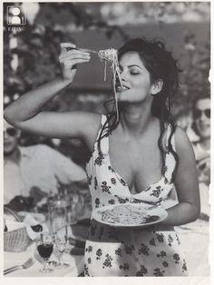Classic Italian girl eating pasta -- molti baci!