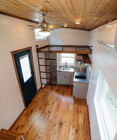 The Triton features painted shiplap walls, a stained ceiling, and pre-finished hardwood floors. Loft Storage, Stair Storage, Built In Storage, Tiny House Living, Home And Living, Cottage House, Prefinished Hardwood, Hardwood Floors, Glass Subway Tile Backsplash