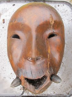 """Excavations at Nunalleq, on the Alaskan coast of the Bering Sea have uncovered some amazing artifacts, like this Yup'ik Wooden Mask: """" """"It's got amazingly lifelike contours with the cheek bones, and the nose, and the forehead and so on,"""" Rick Knecht of the University of Aberdeen told Alaska Public Media. The team also found a bentwood bowl among other household items, jewelry, and weapons in the 500-year-old sod house, which was burned and abandoned around 1640."""""""