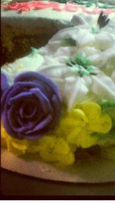 Royal icing flowers on basket weave
