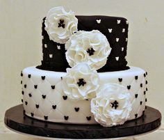 Mickey Mouse wedding anniversary cake.....Wanting this for our 20 yr Anniversary but the Mickey's to be silver