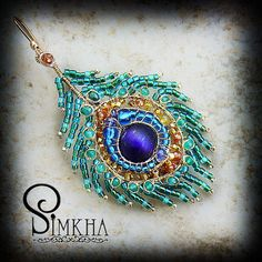 "Handmade by Simkha.  Peacock feather earrings ""are made of precious stones and gold-filled.""  [Site is in Russian]"