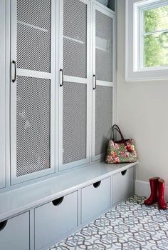 Image result for mudroom cubbies with punched metal doors