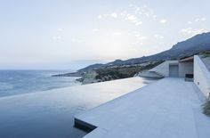 The overall design strategy was to segregate the rural areas of the landscape from the wild ones with clearly defined borders that form four distinct corrals. The home is organized around exterior courtyards which are used to funnel and control the prevailing winds and provide passive ventilation. #home #sea #greece #grecia #islascicladas #pizarra #acantilado #cliff #architecture #arquitectura #selectahome #piscina #terraza #piscinadeborde #swimmingpool #vivienda