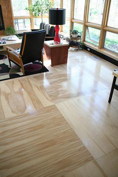 """Plywood """"tiles"""":  It comes in 4×8 sheets for about $40, so that's a little more than a buck a square foot. And you can paint it"""