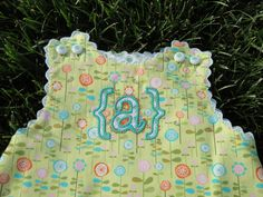 Applique On Childs Romper.  Baby Bet Font.