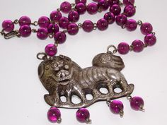 Vintage Chinese Silver Foo Dog Necklace. $200.00, via Etsy.
