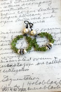 Dangling from sterling wire are Gorgeous One of a Kind Vintage Creamy Pearl and Peridot Earrings. Touch of Sparkling Rhinestone finishes up~ The