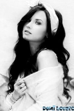 Demi Lovato. I love her because she's down to earth, even though she's been through a lot. She's come along way. Demi shows how even though you have hard times you can still stay strong and wait for everything to happen when its ready. I  think that she's amazing role model because she shows that even though you have flaws you don't have to put yourself down just  because other people do it to you. She really is a great singer as well.