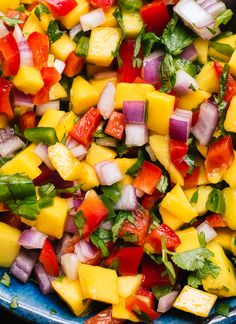 Fresh mango salsa recipe! So simple and so good. cookieandkate.com