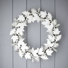 A stunning and unique cardboard leaf wreath in white.Featuring oak, pine and maple leaf pieces it is easy to assemble, coming flat packed with detailed instructions. Makes a great addition to a modern or traditional interior - the perfect housewarming gift! Keep it white, modern and simple or customise with paint, newspaper, wrapping paper, glitter or other craft materials.Made from recycled cardboard.Approx 53cm diameter, 8cm depth