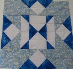 The Alaska quilt block is a beauty, with icy shades of light blue fingers reaching into the central area. A lovely block shown with 3 quilt suggestions