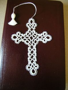 I have shuttle tatted this cross with a soft shiny WHITE thread. It measures about 4.5X3.5 inches. Hello, A portion of this sale goes to Alzheimer's Awareness. Andrea.