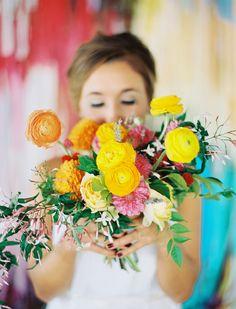 wild ranunculus and dahlia bouquet, photo by Ben Q Photography, flowers by Bows and Arrows http://ruffledblog.com/color-pop-wedding-ideas #flowers #weddingbouquet #bright