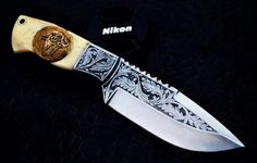 Engraved hunting knife by Imran Bhutta Immi.