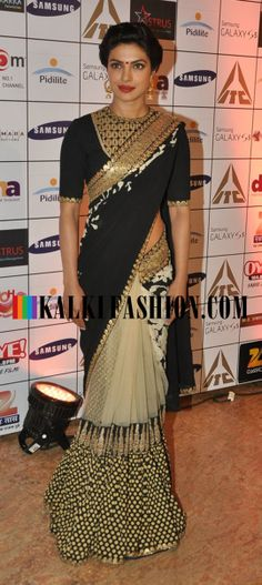 Priyanka Chopra in a half and half black and beige saree by Sabyasachi attends Dilip Kumar's autobiography book launch.
