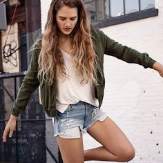 Varsity Cues: Layer lightweight bomber jackets over your favorite summer tops for a modern, sportswear-inspired look.