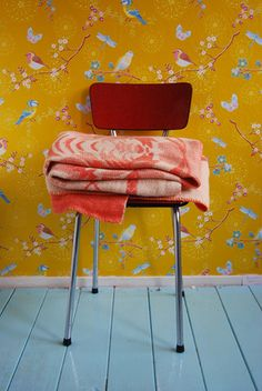lovely wallpaper and chair and plaid