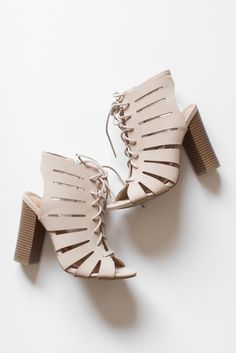 """Nude open toe lace-up sandals featuring faux leather strappy upper and a cut-out back heel. Heel height is approx 4.5"""". Lightly padded insole for comfort with a non-skid rubber sole. All man made material True to US size Imported"""