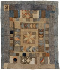 Hand-stitched cotton and wool back-country quilt, varying star and other geometric elements, quilted blue borders, American, 19th century, 79 x 63 in.