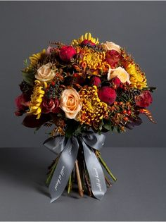 Wild At Heart - Autumnal Romantic Bouquet  - A dreamy mix of red piano roses, peachy avalanche roses, Tom Pierce blooms and red hypericum berries, the perfect gift for a loved one. Picture showcases our large bouquet.