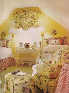 This would be an adorable room for children or visiting grandchildren.  The beds are painted with a floral design that coordinates with the fabrics/upholstery in the room!