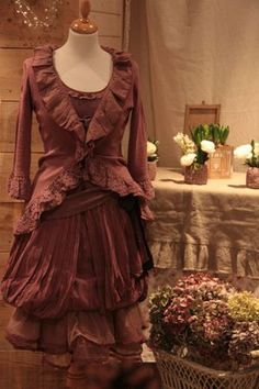 Love the nipped in waist, and the rosewood color.