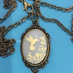 Hummingbird cameo Inch long in 24 inch chain ca be made shorter if desired Jewelry Necklaces