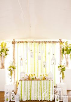 ribbons and hanging lanterns suspended from a birch arch  photo credit @Rowell Photography
