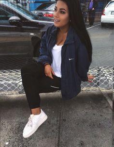 Navy blue nike jacket, white t shirt, black leggings, and nike air force 1