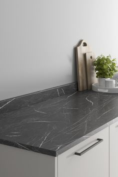 Looking for black marble countertops ideas? Our Howdens Stratus Black Marble Effect Laminate Worktop Howdens Midnight Marble Effect Laminate Worktop looks amazing when paired with a grey slab kitchen and black kitchen hardware. These black marble effect kitchen countertops are affordable and are perfect for creating texture in your modern kitchen design. Howdens Worktops, Kitchen Worktops, Black Marble Countertops, Kitchen Hardware, Marble Effect, Work Surface, Work Tops, Everyday Items, Black Kitchens