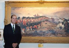 "Prince William Photos Photos - Prince William, Duke of Cambridge stands next to the painting, ""The Thin Red Line"" during a visit to Stirling Castle on October 24, 2016 in Stirling, Scotland.  The Duke of Cambridge in his role as Earl of Strathearn is Patron of The Thin Red Line Appeal to redevelop The Argyll and Sutherland Highlanders Regimental Museum at the Castle. - Duke Of Cambridge Visits Stirling Castle"