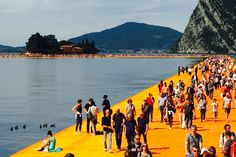 For 16 days Italy's Lake Iseo will be reimagined. 100,000 square meters of shimmering yellow fabric, carried by a modular floating dock system of 220,000 high-density poly-ethylene cubes, will undulate with the movement of the waves as _The Floating Pi...