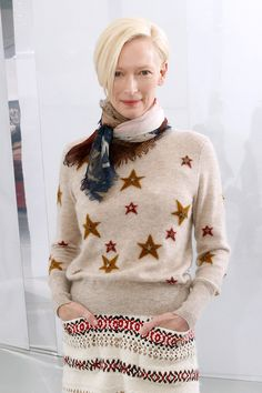 Tilda Swinton with platinum blond hair at the Chanel couture show, and her face was practically makeup free.