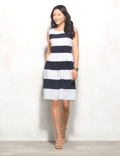 The nautical trend always gets us in the mood for spring and summer. Wear a red lip with this navy and white striped dress for an instant nautical-chic look. Imported.