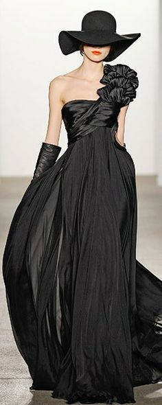 Well well well, what do we have here, a gorgeous black flowing gown and a floppy black hat!