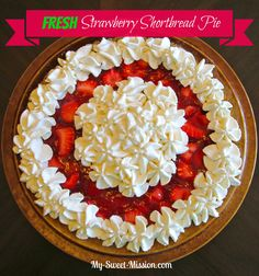 My Fresh Strawberry Shortbread Pie has a buttery shortbread crust with fresh glazed strawberries and a beautiful whipped cream design. It's a special dessert for any occasion!