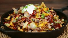 Recipe with video instructions: Who needs nachos when you can enjoy cheesy fries topped with tender pulled pork and BBQ sauce? Ingredients: pounds pork shoulder, Salt and pepper, 1 cup root. Pulled Pork Nachos, Pulled Pork Recipes, Barbecue Recipes, Fries Recipe, Salmon In Puff Pastry, Bbq Sauce Ingredients, How To Make Bbq, Homemade Barbecue Sauce