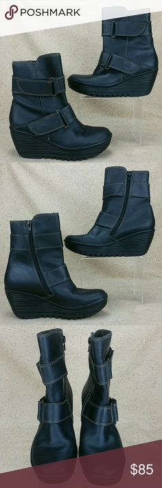 London Fly Yaki Zip Wedge Ankle Boots W 37 These boots are pre-owned in nice condition. Gentle wear on the outside from use includes creasing and minor scratches/scuffs. Some wear to the bottoms. London Fly's size chart converts size 37 to US 6.5-7. Look over the pictures carefully before purchasing. Fly London Shoes Ankle Boots & Booties