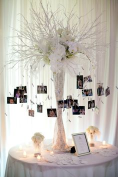 photo display inspiration. I don't like this arrangement, just the idea of hanging photos of you out of the arrangement. This could be on the guest book table