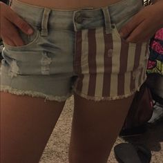 Denim W/ American flag Iris Brand Denim Shorts w/ American flag design on the front and upper back. Size says LG. But  these shorts are really between a Sz.3 and a Sz. 5 Iris jeans Shorts Jean Shorts