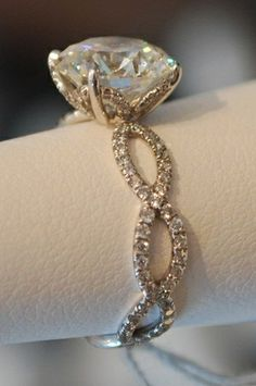 Okay girlfriends, this is THE ONE to tell Brian about! I LOVE, LOVE, LOVE THIS ONE!!! The infinity symbol has a lot of meaning to us. It's PERFECT! infinity symbol on an engagement ring or wedding ring #diamond_ring #infinity #wedding_ring #engagement_ring